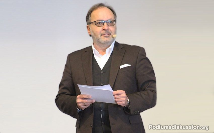 Martin W. Puscher Moderator Podiumsdiskussion